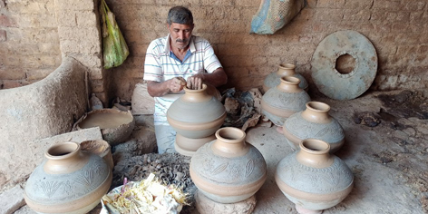 A potter in Samba village busy in giving final shape to earthen pots. —Excelsior/Badyal