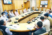 Divisional Commissioner Kashmir, P K Pole chairing a meeting on Tuesday.