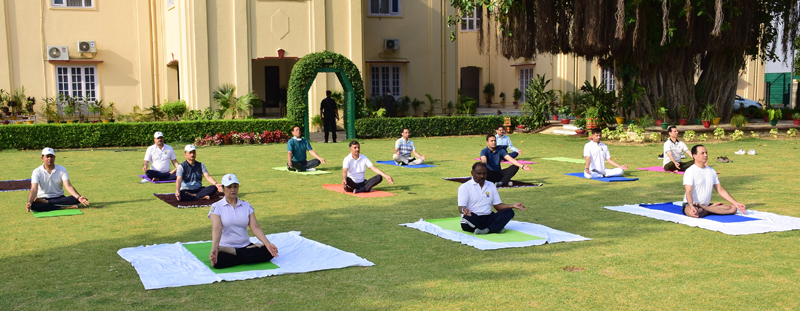 Lt Governor of J&K UT and staff of Raj Bhawan Jammu practicising Yoga on Sunday.