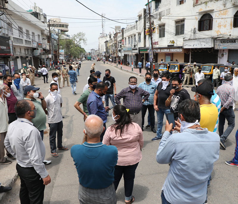 Shopkeepers protesting at Residency Road in Jammu on Wednesday. —Excelsior/Rakesh