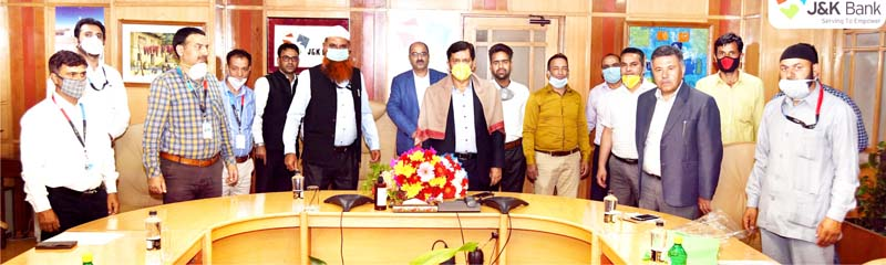 J&K Bank Chairman RK Chhibber posing with JKBEU members at Bank's corporate headquarters in Srinagar.