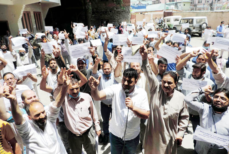 Daily wagers protesting in Srinagar on Tuesday.