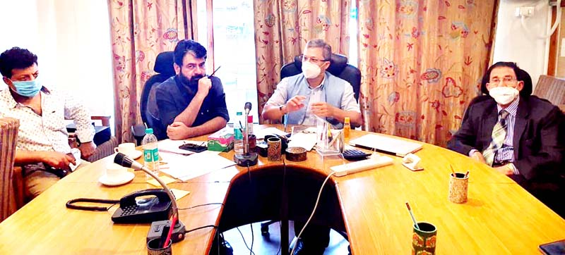 KCCI members and hoteliers in a meeting at Srinagar on Monday.