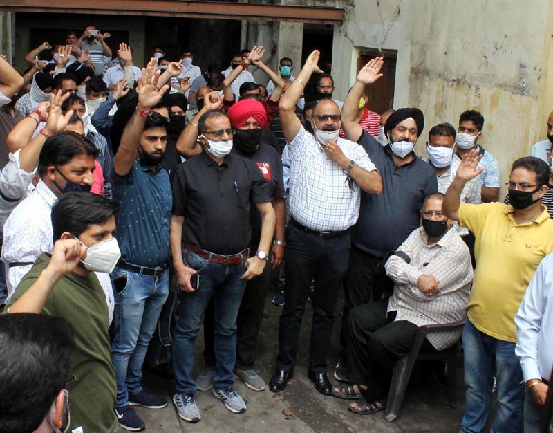 Power employees protesting at Jammu on Monday. -Excelsior/Rakesh
