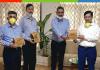 J&K Bank Director and AoL Trustee, Vikram Gujral presenting immunity booster kit to CMD J&K Bank, RK Chhibber.