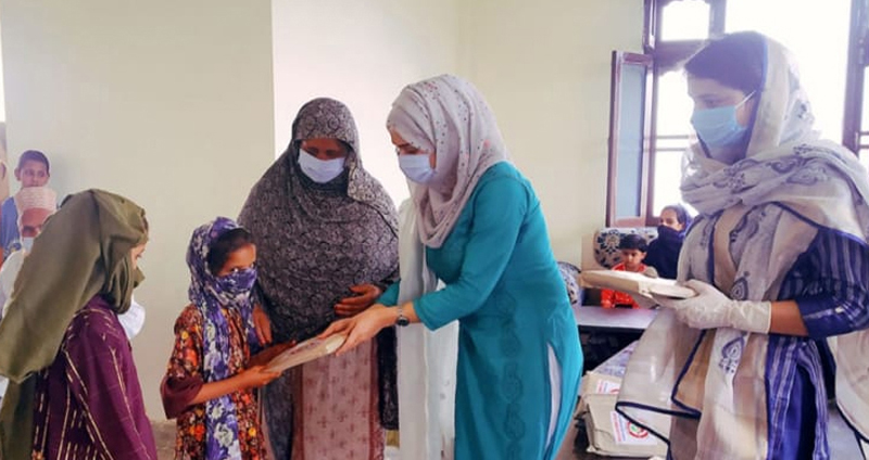 'Stationery Kits' being distributed among girl students.