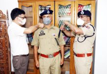 DGP Dilbag Singh decorating newly promoted DySP.