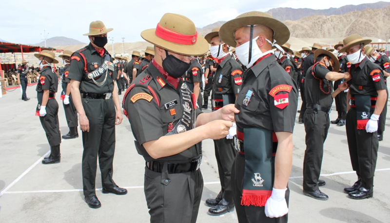 Officer pinning medal to a soldier for his outstanding performance during training.