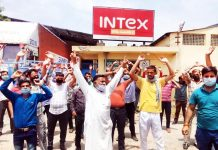 Workers protesting in front of INTEX Industries Bari Brahmana on Wednesday. -Excelsior/Badyal