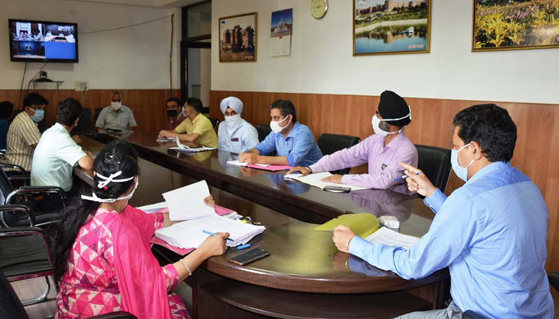 Divisional Commissioner Jammu Sanjeev Verma chairing a meeting on Monday.