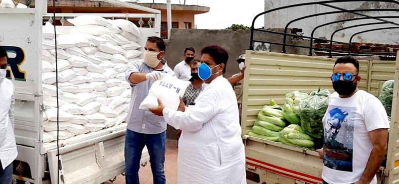 Former Minister Raman Bhalla distributing ration item among needy in Gandhi Nagar constituency, Jammu.
