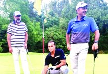 Golfers posing for a group phtograph at Royal Springs Golf Course Srinagar.