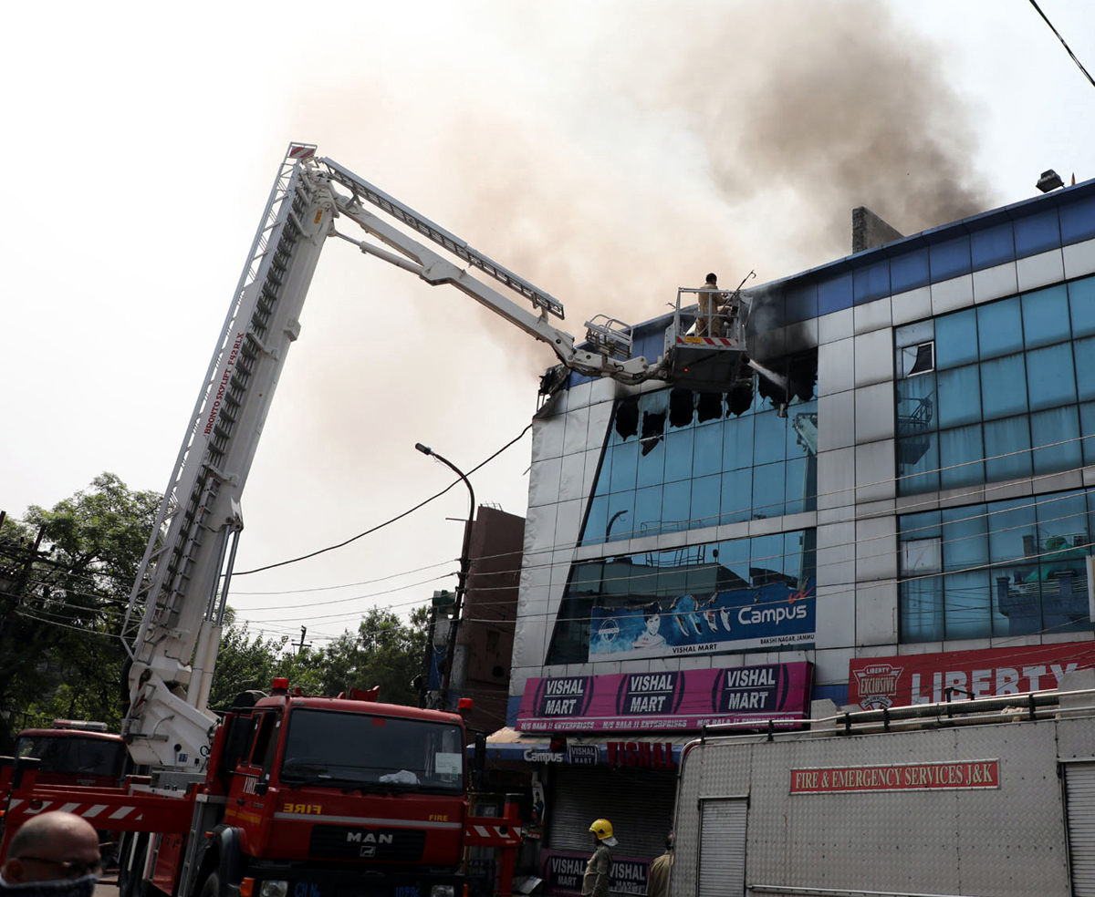Fire fighters engaged in dousing flames. -Excelsior/Rakesh