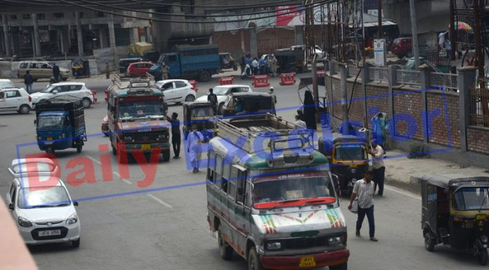 Public transport operates on a road in Srinagar on Saturday. —Excelsior/Shakeel