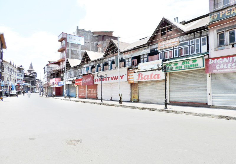 A deserted view of business hub Lal Chowk in Srinagar during lockdown enforced by the authorities following spike in COVID-19 cases on Sunday. (UNI)