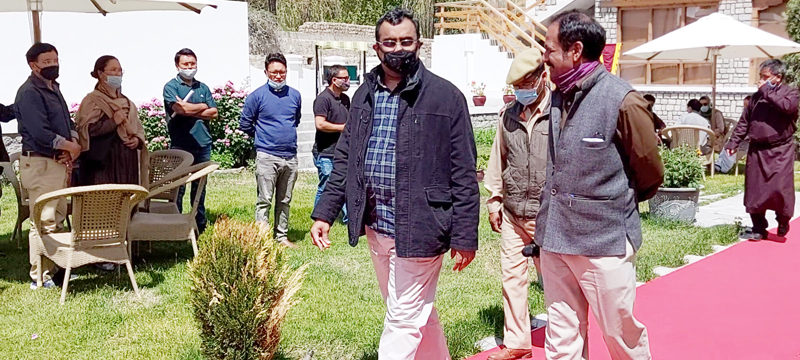 BJP leader Ram Madhav with party leaders in Leh on Sunday. — Excelsior/ Morup Stanzin