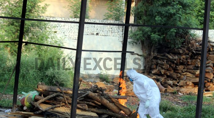 COVID victim being cremated at Shakti Nagar in Jammu on Tuesday. -Excelsior/Rakesh