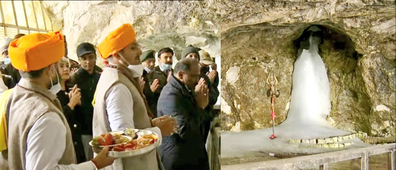 Lieutenant Governor Girish Chandra Murmu along with family and officials performing the first Aarti and puja at the holy cave of Shri Amarnathji on Sunday. (UNI)