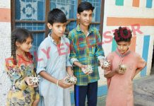 Children show shells fired by Pakistan army in Balakote sector on Wednesday. —Excelsior/Rahi Kapoor