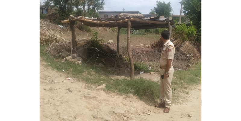 Bhambla in Reasi district being contained by police after Corona positive case on Saturday. -Excelsior/Romesh Mengi