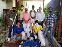 J&K BJP Vice President Yudhvir Sethi presenting cricket kit to young players.