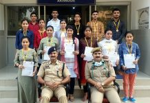 SDPO Akhnoor Ajay Sharma posing with toppers in Akhnoor on Monday.