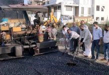 Former Deputy Chief Minister, Kavinder Gupta kick starting black topping of road at Dilli on Monday.