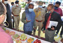 Lt Governor inspecting stalls during Kisan Mela-cum-Awareness Camp at Pulwama.