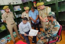 Excise Commissioner Rajesh Shavan inspecting an army canteen.