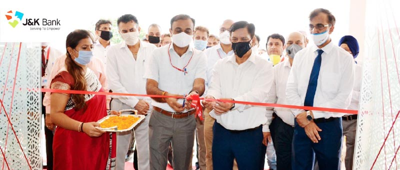 CEO SMVD Shrine Board Ramesh Kumar inaugurating the new BU of J&K Bank in the presence of the Bank's CMD Rajesh Kumar Chhibber and other officers.