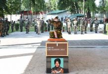 Tributes being paid to martyr Rajwinder Singh at Badami Bagh Cantonment in Srinagar on Wednesday.