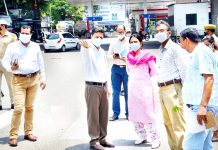 Divisional Commissioner Sanjeev Verma and Deputy Commissioner Sushma Chauhan during tour of Jammu city on Monday.