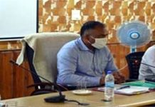 Divisional Commissioner Kashmir P K Pole chairing an interactive session.