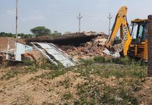 JCB engaged in retrieving encroached land. —Excelsior/Badyal