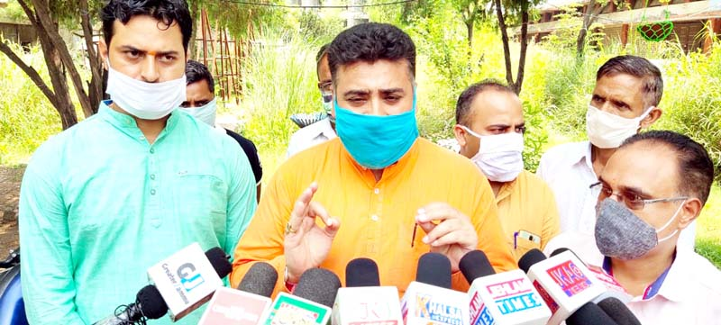 AJKPC president Anil Sharma addressing press conference in Jammu on Monday.