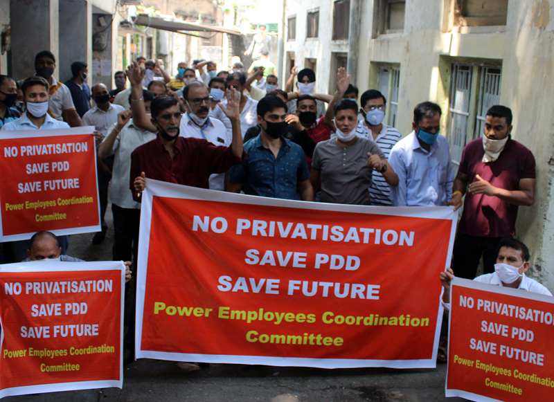 Employees and engineers of PDD during a protest demonstration at Jammu on Saturday. -Excelsior/Rakesh