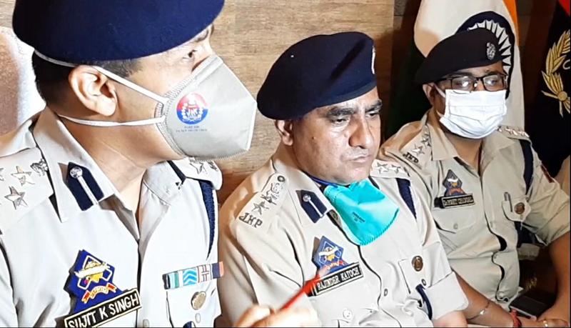 DIG Udhampur-Reasi Range Sujit Kumar, flanked by other officers addressing press conference at Udhampur. — Excelsior/ K Kumar.