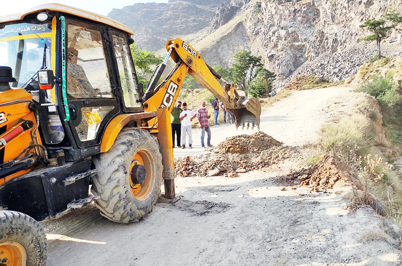 Earthmovers digging road leading towards Pantha Chowk quarry belts in Srinagar outskirts.