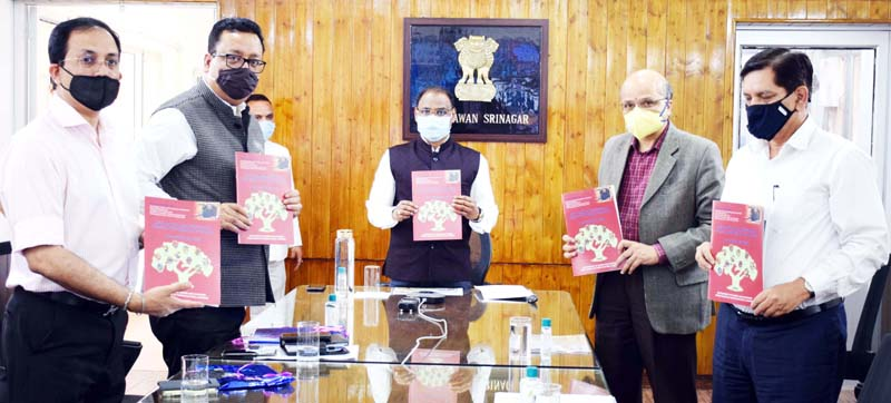 Lt Governor Girish Chandra Murmu releasing book on horticulture on Tuesday.