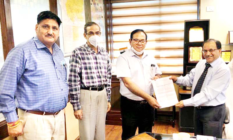 CGM NABARD Rakesh Kumar Srivastava handing over sanction letter for the fund assistance to JKGB Chairman Janak Raj Angural at Regional Office Jammu.