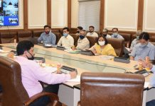 Principal Secretary, H&UDD chairing a meeting on Thursday.