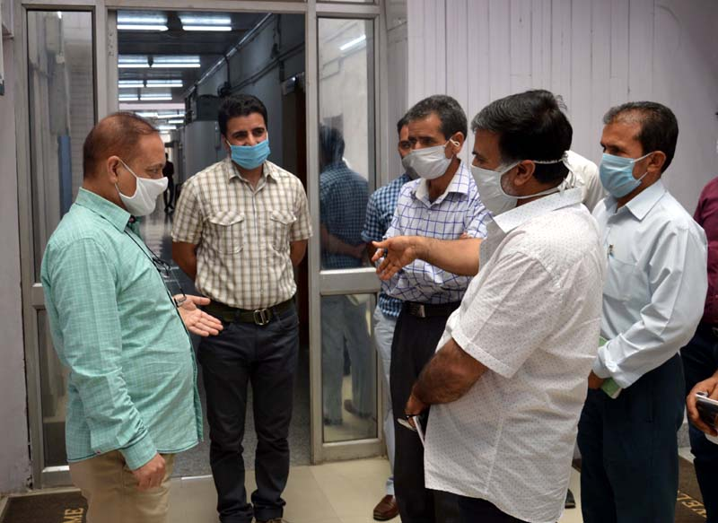 Financial Commissioner Revenue Dr Pawan Kotwal reviewing preparedness for launch of On-line Registration in Srinagar on Tuesday.