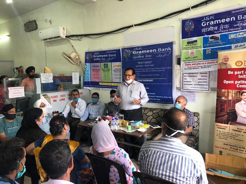 Chairman J&K Grameen Bank Janak Raj Angural addressing a gathering.