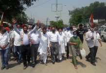 Cong activists taking out protest rally against Modi Govt at RS Pura town on Thursday.
