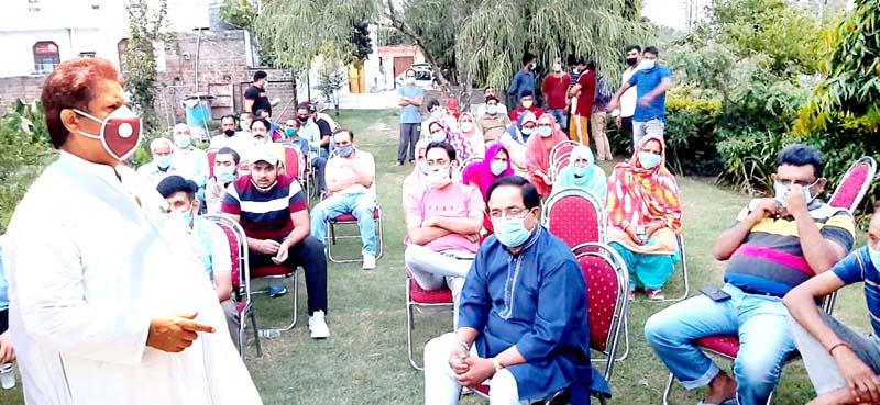 Senior Cong leader Raman Bhalla interacting with people at Jallo Chak in Jammu on Sunday.