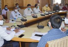 Divisional Commissioner Kashmir chairing a meeting on Tuesday.