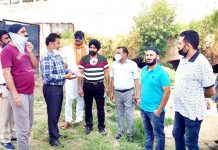 Chairman, Sanitation Committee, JMC Baldev Singh Billawaria with JMC officials inspecting Gangyal Nallah on Sunday.