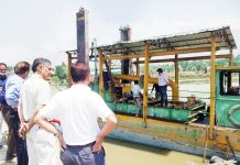 VC, Lawda supervising dredging of Settling Basin on Monday.