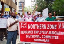 LIC employees staging protest in Jammu on Friday.