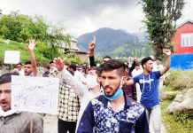 People raising slogans during protest march.